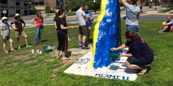 Three Summers Students Painting the UConn Rock
