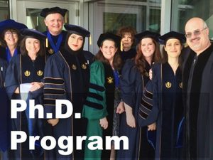 Photo of Ph.D. graduates with link to information about the Ph.D. program